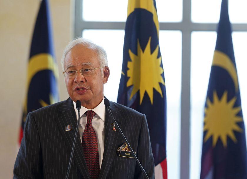 Malaysian Prime Minister Datuk Seri Najib Razak speaks at a joint news conference during the official visit of Australian Prime Minister Tony Abbott in Putrajaya September 6, 2014. — Reuters pic