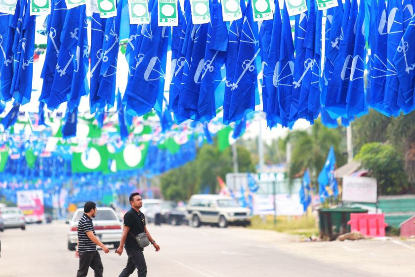 Malaysia ranked fifth from the bottom in a survey of 54 countries on integrity of campaign financing in elections. File picture shows Barisan Nasional and PAS flags flying in Pengkalan Kubor, September 23, 2014. ― Picture by Saw Siow Feng