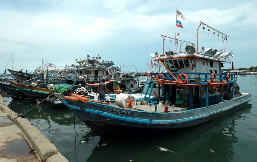 File photo showing fishing trawlers in Semporna. — Picture by Julia Chan