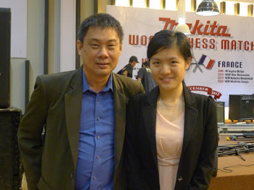 The writer with Hou Yifan at the MAKITA Indonesia-France Match in Jakarta, December 2012. — Picture courtesy of Peter Long