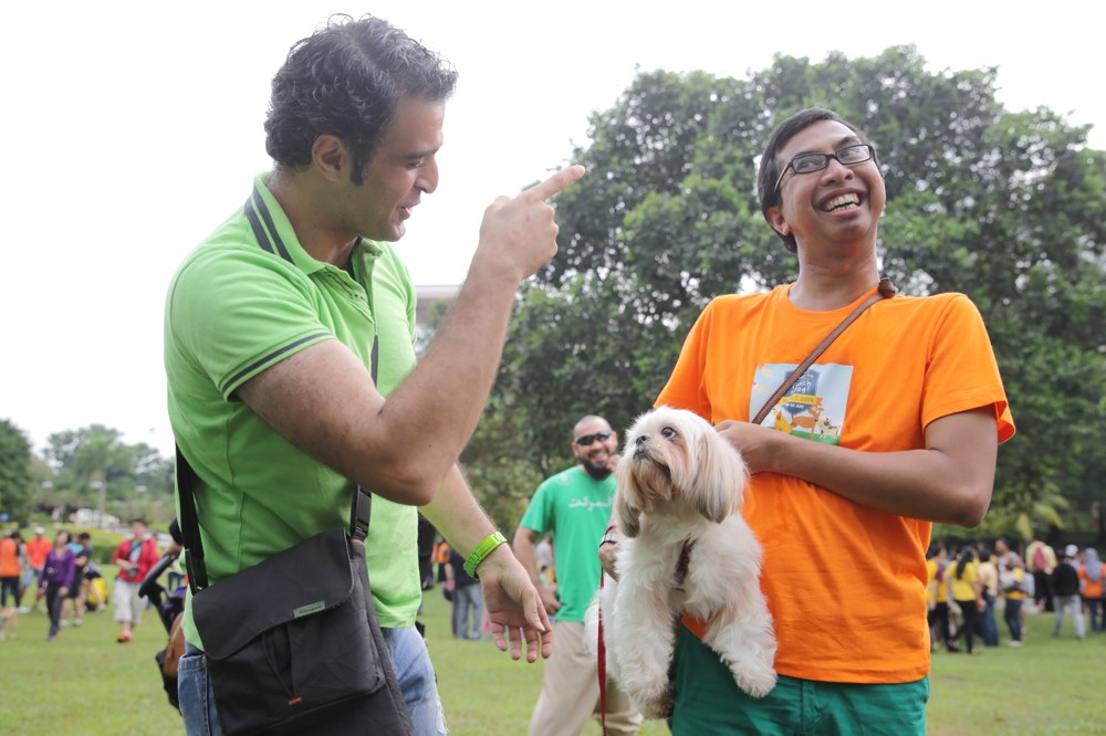 Syed Azmi Al Habshi (left) touches a dog for the first time at the 'I wanna touch a dog' event at Central Park, Bandar Utama, October 19, 2014. — Picture by Choo Choy May