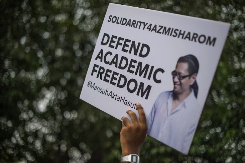 A student from the University of Malaya holds up a placard during a rally against the sedition law at their main campus in Kuala Lumpur on September 10, 2014. — AFP pic
