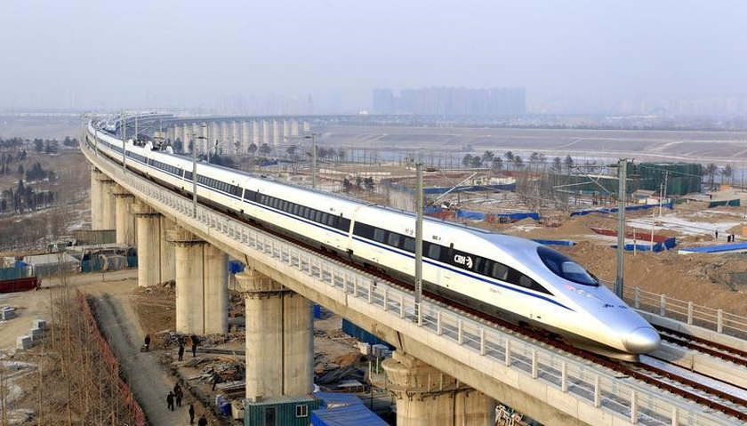 A high-speed train travelling to Guangzhou is seen running on Yongdinghe Bridge in Beijing, December 26, 2012. — Reuters pic