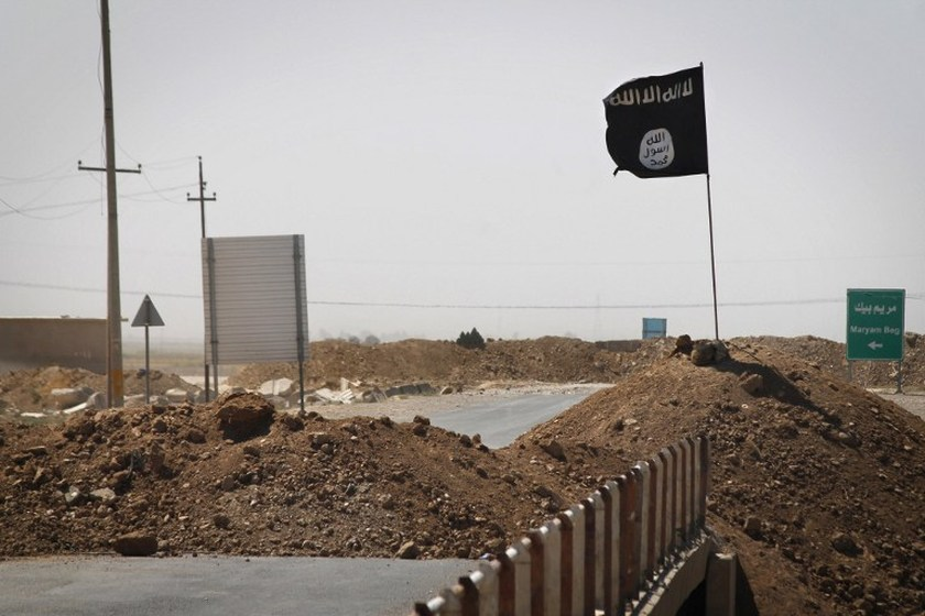 File picture of an Islamic State (IS) flag on the other side of a bridge in Rashad, Iraq September 11, 2014. — Reuters pic