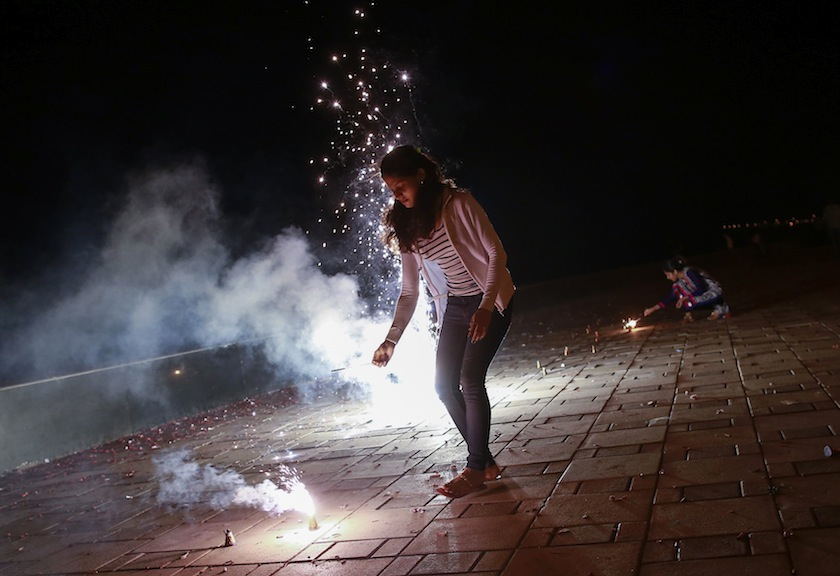 Girls light firecrackers while celebrating the Hindu festival of Diwali, the annual festival of lights, in Mumbai October 23, 2014. — Reuters pic\