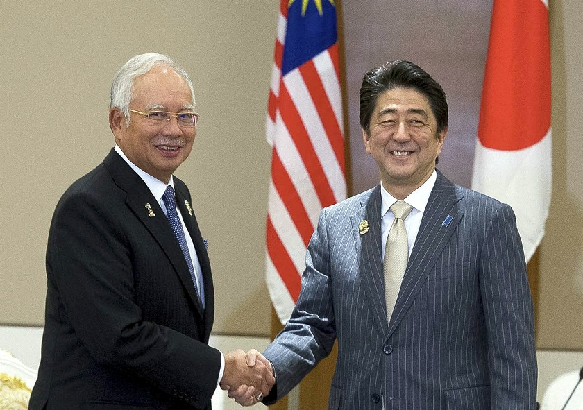 Prime Minister Datuk Seri Najib Tun Razak and his counterpart from Japan, Shinzo Abe (right) hold a meeting at the Asean plus three Summit in Nay Pyi Taw, Myanmar, November 13, 2014. — Bernama pic