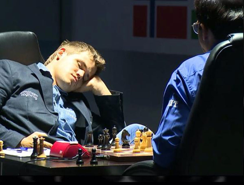 At one point in Game 8, defending champion Magnus Carlsen was so bored he slept