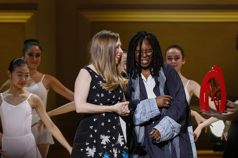 Chelsea Clinton accepts a Glamour Woman of the Year award from actress Whoopi Goldberg during Glamour Magazine's annual awards ceremony in New York November 11, 2014. — Reuters pic
