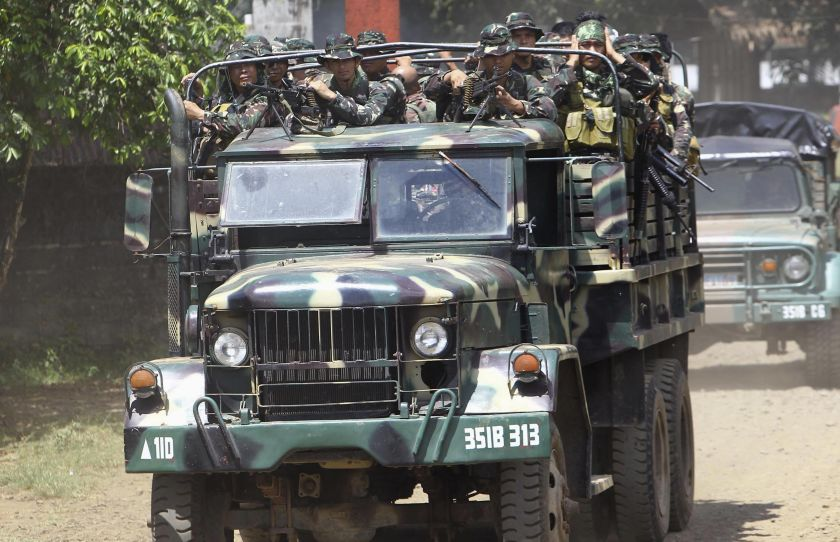 Soldiers ride in a military truck as they are deployed to remote villages in Jolo, Sulu southern Philippines. Security is precarious in the southern Philippines, despite a 2014 peace pact between the government and the largest Muslim rebel group that ended 45 years of conflict. — Reuters pic