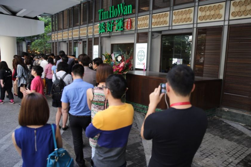 Customers are seen eagerly waiting at the entrance of Tim Ho Wan to taste their famous dim sum, November 28, 2014. ― Picture by Choo Choy May