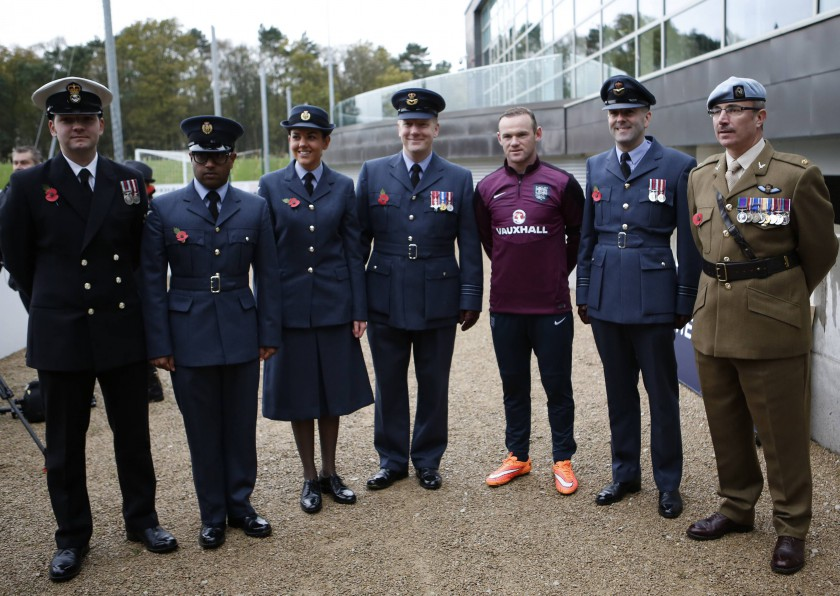 England's Wayne Rooney (third left) is set to earn his 100th cap against Slovenia. — Reuters pic