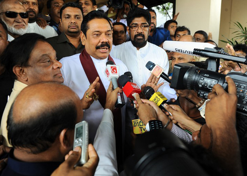 Sri Lankan President Mahinda Rajapakse speaks to journalists after handing over his nomination papers to the Election Commissioner, Colombo, December 23, 2014. — AFP pic