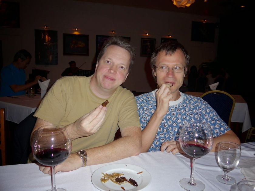 Nigel Short (left) and Sergei Tiviakov trying Mandalay bugs while in Yangon. — Picture courtesy of Peter Long