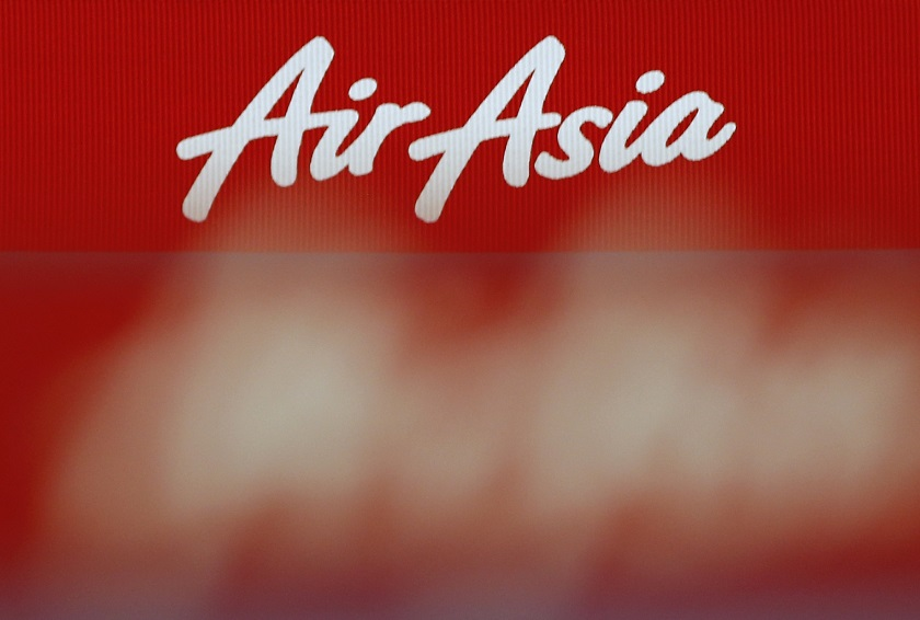 An AirAsia logo is pictured at the ticketing counter at Changi Airport in Singapore, December 29, 2014. — Reuters pic
