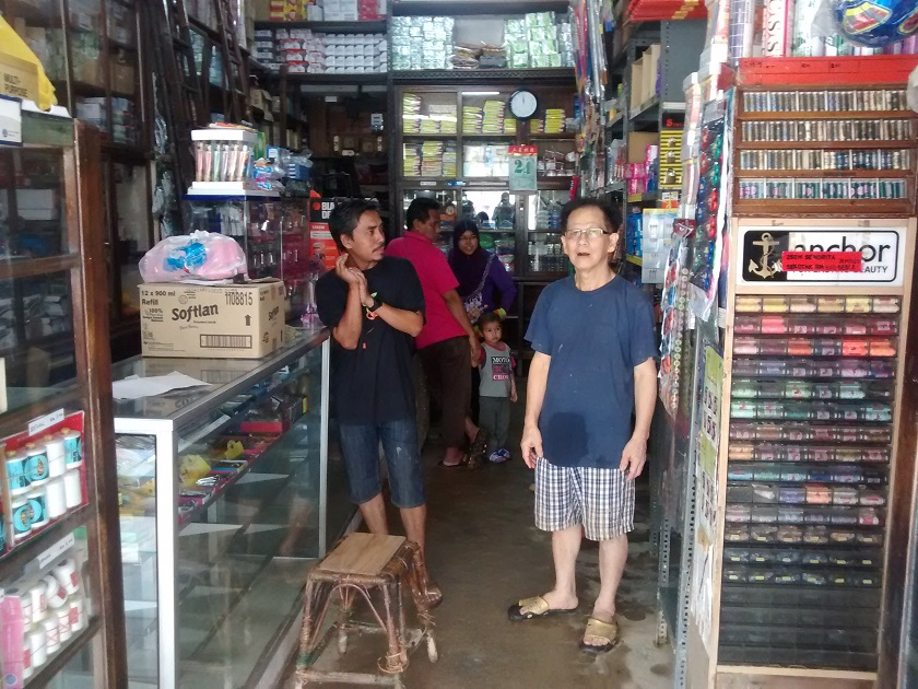 Sundry shop owner Tan says he and his wife will do anything to start cleaning up in order to resume operating as quickly as possible at their shop in Jalan Temenggong, December 30, 2014. — Picture by Syed Jaymal Zahiid