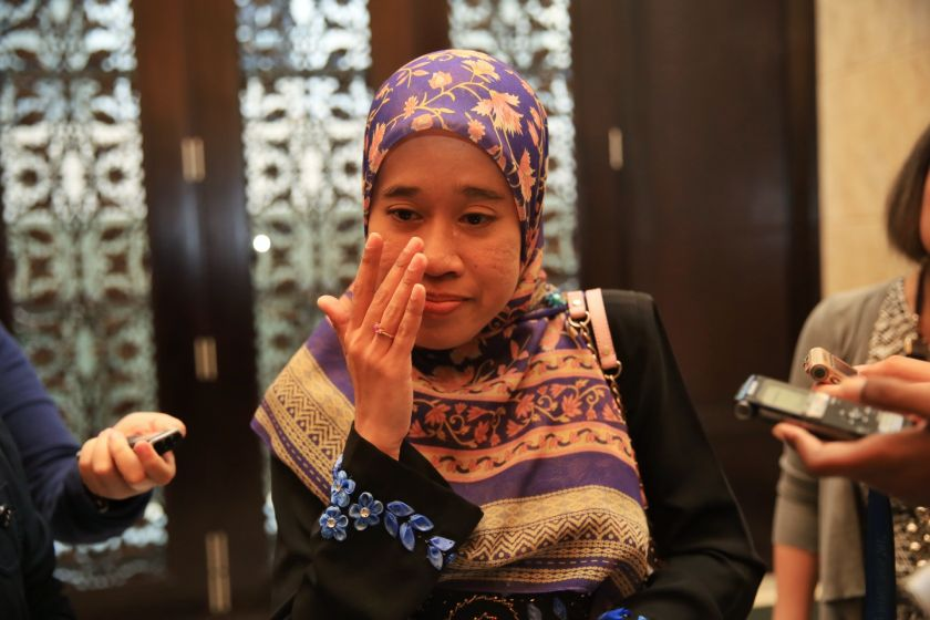 An emotional Nik Raina Nik Abdul Aziz speaks to members of the media after the Court of Appeal ruled in her favour, dismissing JAWI's contest against a High Court ruling. — Picture by Saw Siow Feng