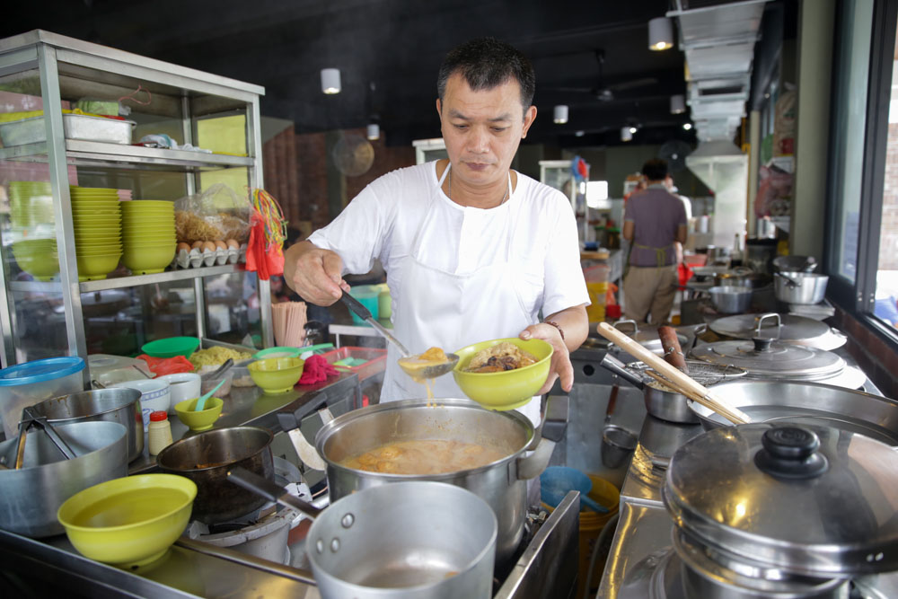 Lai Weng Choi runs the pan mee and curry mee stall with his wife.