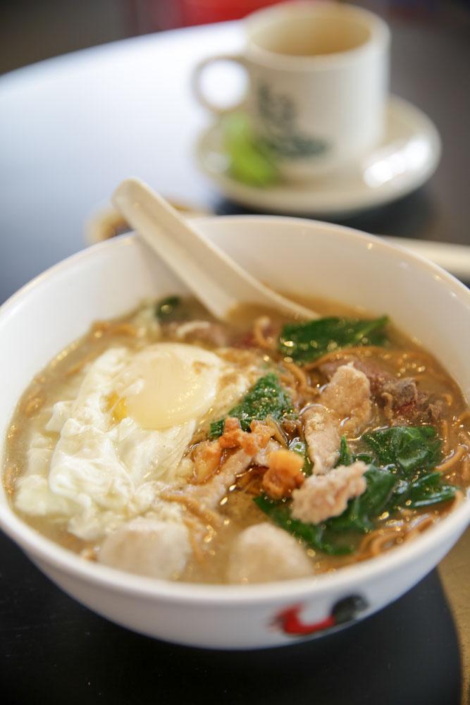 Mui Chea's luscious pork noodles with an egg.