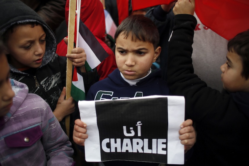 A Palestinian boy holds up a sign during a protest against the attack in Paris on satirical French newspaper Charlie Hebdo, in the West Bank city of Ramallah January 11, 2015. The sign reads, 'I am Charlie'.—Reuters pic