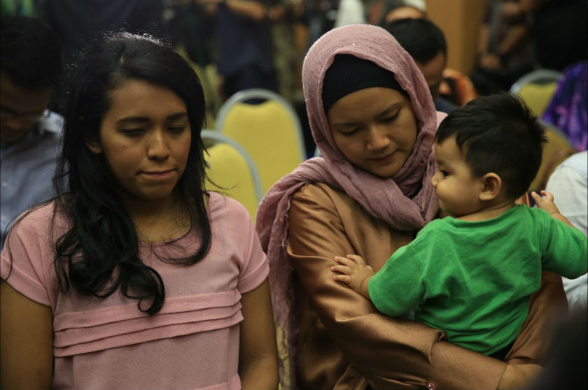 Relatives of crewmembers and passengers of missing flight MH370 are seen in the Department of Civil Aviation Malaysia (DCA) hall where a press conference was scheduled, in Putrajaya, January 29, 2015. — Picture by Saw Siow Feng