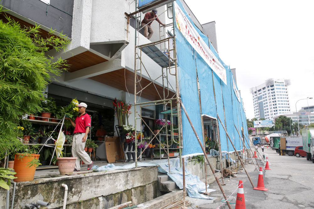 The florists at the front row of the shophouses will be relocated after Chinese New Year.