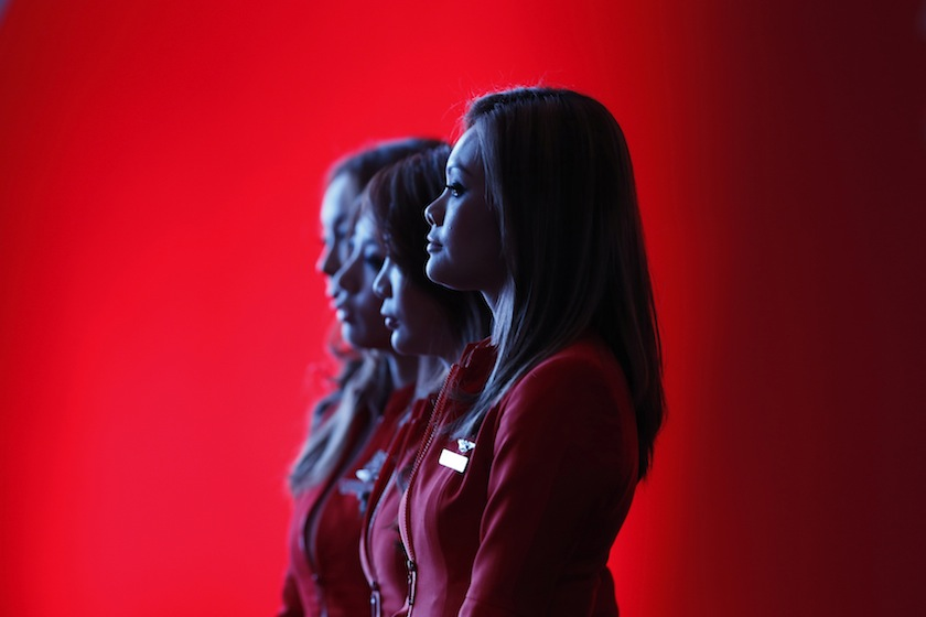 Flight attendants of the long-haul carrier AirAsia watch a performance during the launch of the company's prospectus in Kuala Lumpur in this June 10, 2013 file photo. —Reuters pic