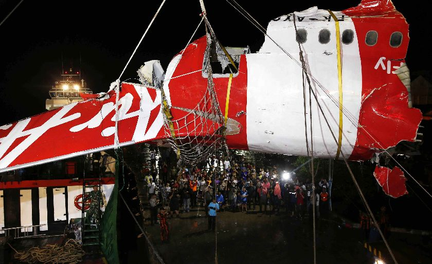 A section of the tail of AirAsia QZ8501 passenger plane is lifted off a ship and onto the back of a truck, the day after it was lifted from the seabed, in Kumai Port, near Pangkalan Bun, central Kalimantan January 11, 2015. — Reuters pic