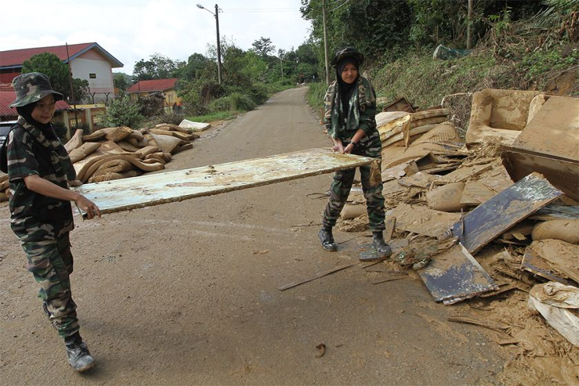 Army men and women were seen bringing out water-damaged furniture and mattresses to a dumping ground across the road.
