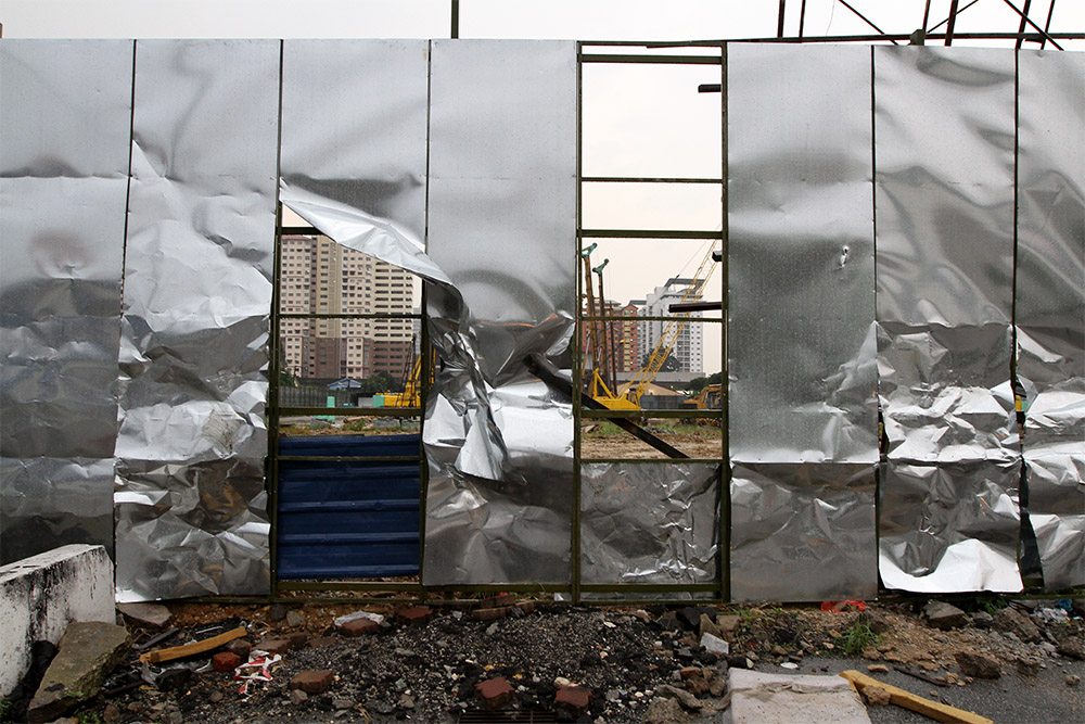 The damaged hoarding of the Datum Jelatek Project is seen following a demonstration by a group of residents in Taman Keramat, Kuala Lumpur, January 25, 2015. — Picture by Yusof Mat Isa