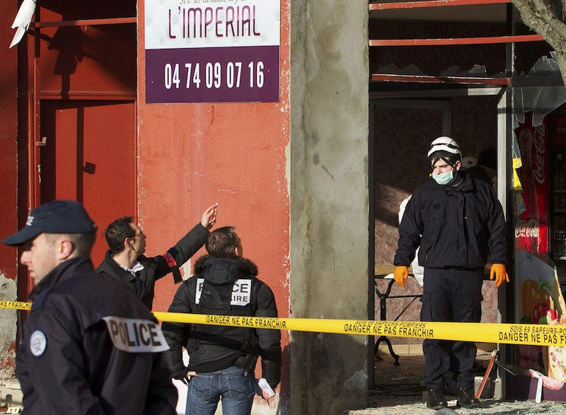 French police and police investigators inspect the scene after an attack at a kebab restaurant near el Houda mosque in Villefrance-Sur-Saone near Lyon January 8, 2015 the day after a shooting at the Paris offices of Charlie Hebdo. — Reuters pic