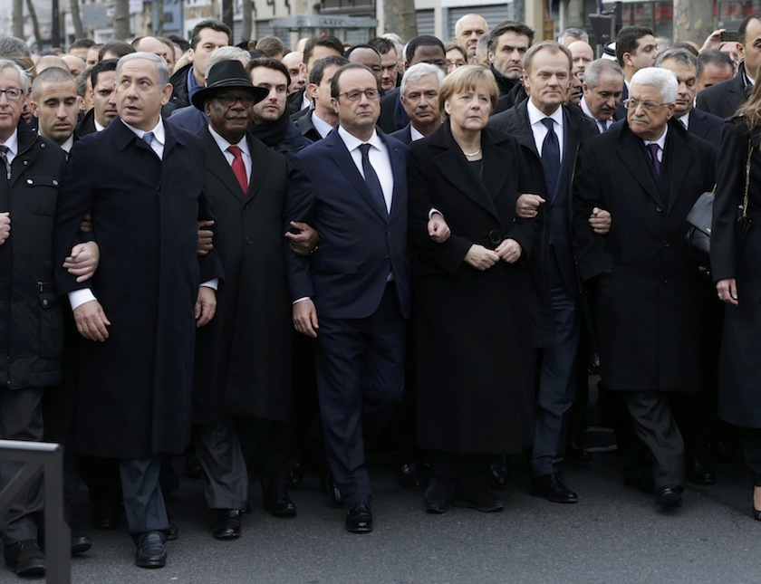 Francois Hollande is surrounded by Heads of state (from left) Benjamin Netanyahu, Ibrahim Boubacar Keita, Angela Merkel, Donald Tusk and Mahmoud Abbas as they attend the solidarity march (Marche Republicaine) in the streets of Paris January 11, 2015.—