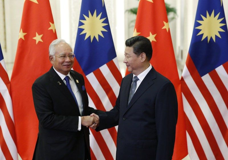 China's President Xi Jinping (right) greets Najib Razak at the Great Hall of the People on the sidelines of the Asia Pacific Economic Cooperation (Apec) meetings in Beijing, November 10, 2014. — Reuters file pic