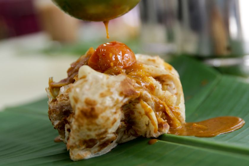 The iconic roti canai with its light texture and crispy bits is best eaten with dhal and curry.