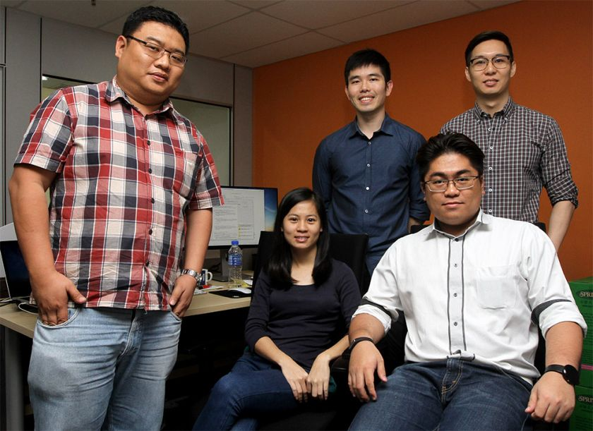 Snappymob co-founders Alvin Ting (left) and Allen Ding (third from the left) poses with the start-up staffs at their office. ― Picture by Yusof Mat Isa