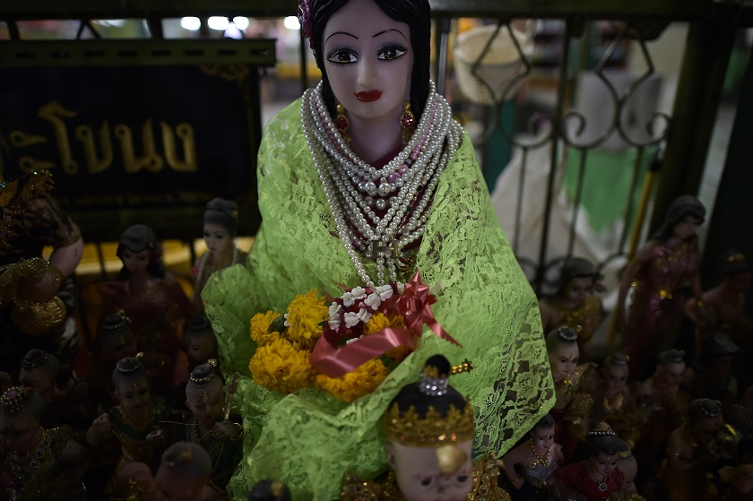 This picture taken on January 15, 2015 shows a statue of the famous ghost 'Nak', a woman who Thais believe lived in the nineteenth century and died during childbirth, at her shrine sheltered in a Buddhist temple in Bangkok. — AFP pic