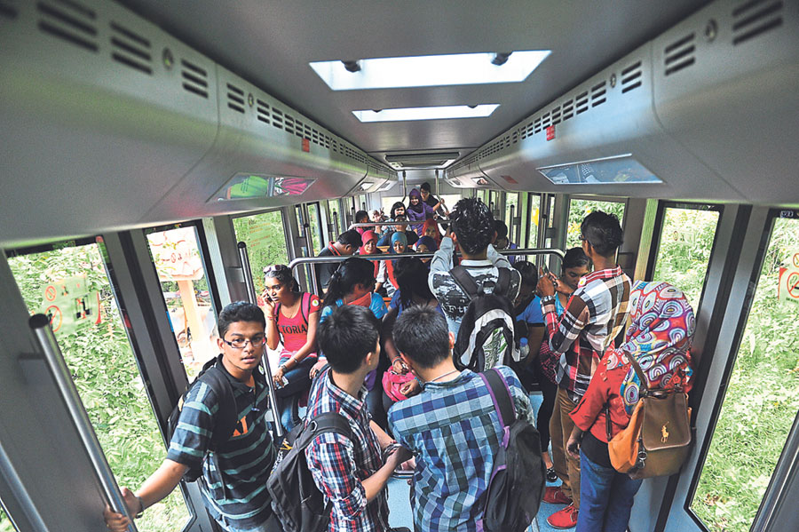 Visitors take a train coach up Penang Hill. The number of visitors has been increasing over the years. — Picture by Malay Mail