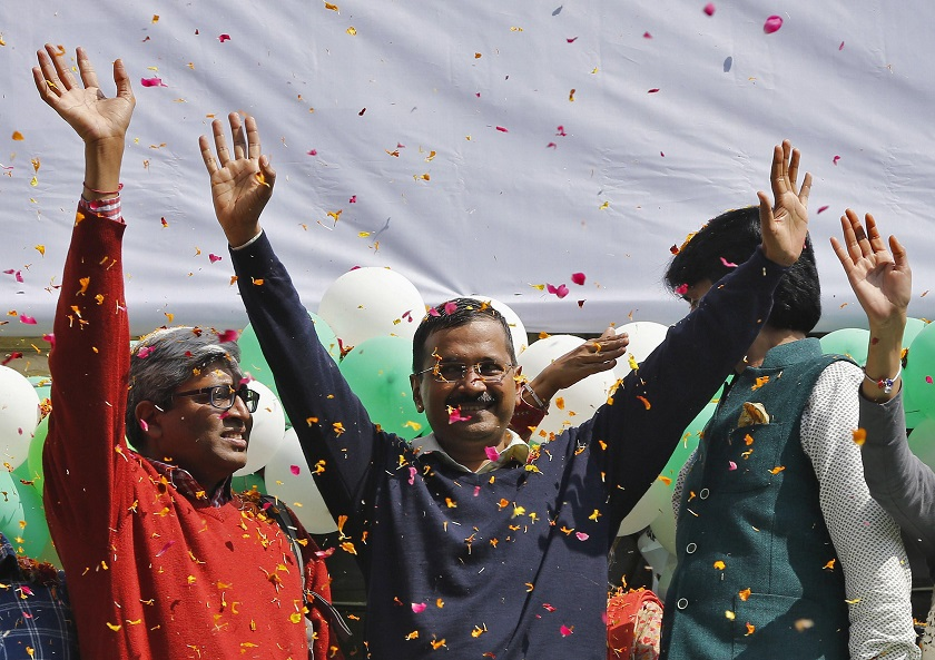Aam Aadmi (Common Man) Party (AAP) chief and its chief ministerial candidate for Delhi, Arvind Kejriwal (centre) waves to his supporters in New Delhi February 10, 2015. — Reuters pic