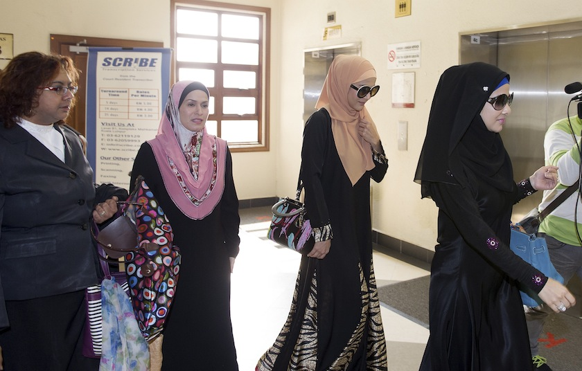 Zahida Mohamed Rafik (second from right) and family members leaving the Jalan Duta Court Complex in Kuala Lumpur, February 26, 2015. —Bernama pic
