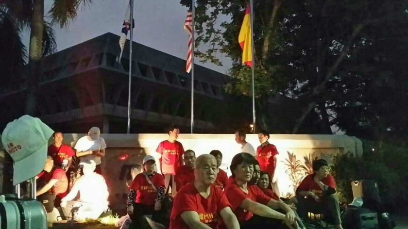 Relatives of missing flight MH370 Chinese passengers have been holding a sit-in outside the MAS Subang office since the afternoon under the hot sun and without shelter, February 13, 2015. — Picture courtesy of Voice370