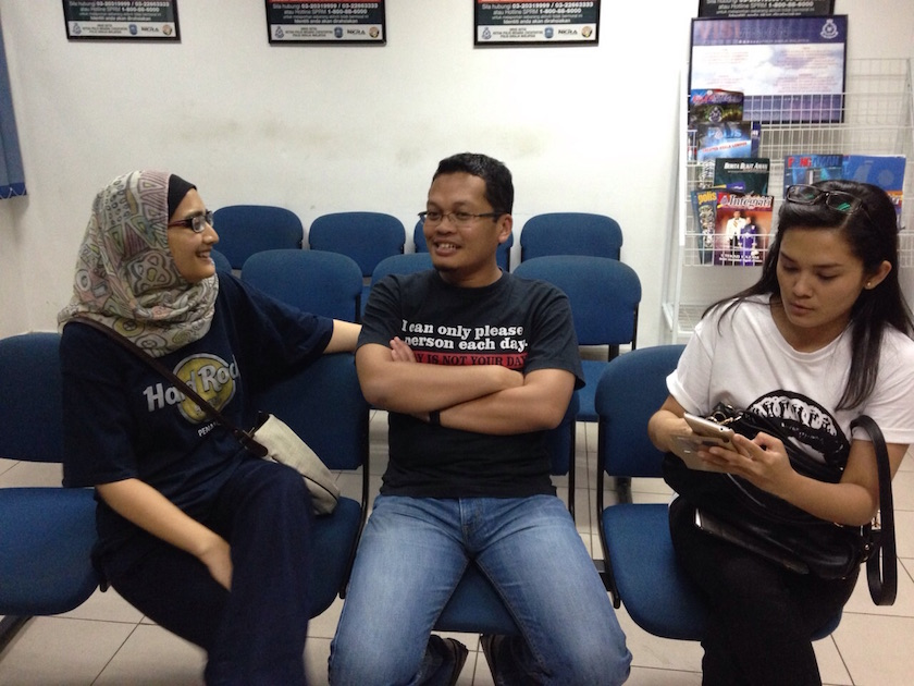 Nik Nazmi Nik Ahmad (centre) is detained at the Jinjang police station for joining a pro-Anwar rally yesterday. He is with his wife Imaan Abdul Rahim (left) and lawyer Melissa Sasidaran. — Picture provided by PKR