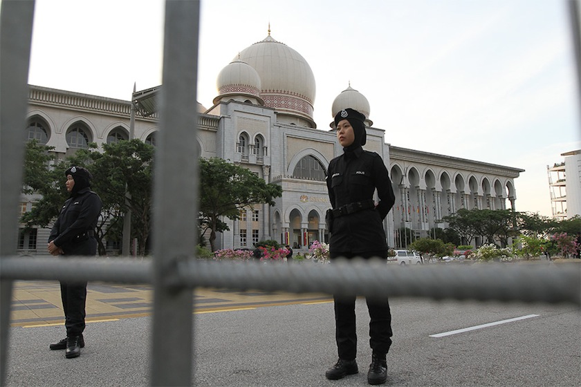 Police officers guarding the entrance to the Palace of Justice, Putrajaya, February 10,2015. — Picture by Yusof Mat ISa