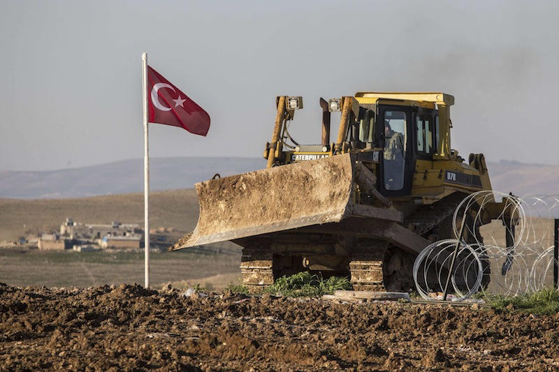 A digger, belonging to Turkish army, is parked next to a Turkish flag at the new site of the Suleyman Shah tomb in the northern Syrian village of Esmesi, Aleppo province, February 22, 2015. — Reuters pic