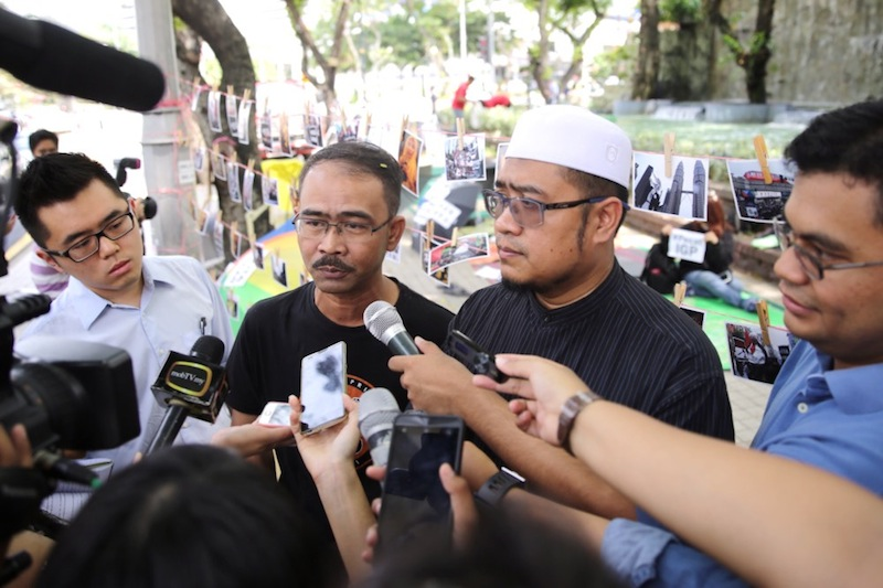 On September 8, 2015, Fariz Musa (second right) had pleaded not guilty to a charge of participating in the the street demonstration which started in front to the Sogo Complex. — Picture by Choo Choy May