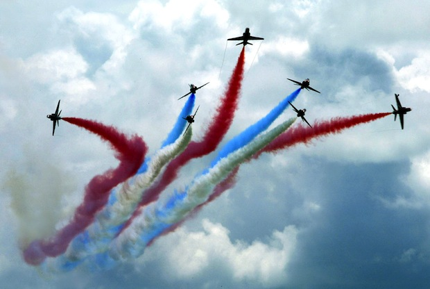 The British Royal Air Force Red Arrows squadron display their acrobatic maneuvers at the Langkawi International Maritime and Aerospace exhibition.— AFP file pic