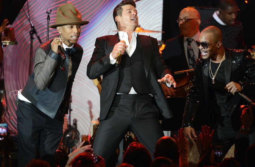 (From left) Pharrell Williams, Robin Thicke and T.I. perform at the Clive Davis Pre-Grammy Gala and Salute to Industry Icons, honoring Universal Music Group Chairman and CEO Lucian Grainge, in Beverly Hills, California in this January 25, 2014 file photo.