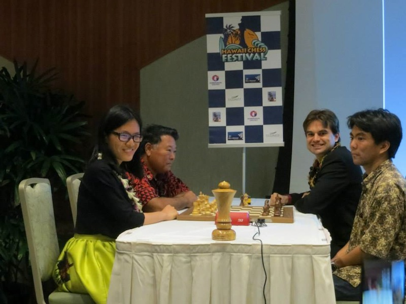 Women's world chess champion Hou Yifan playing an exhibition with the Mayor of Hawaii as her partner.