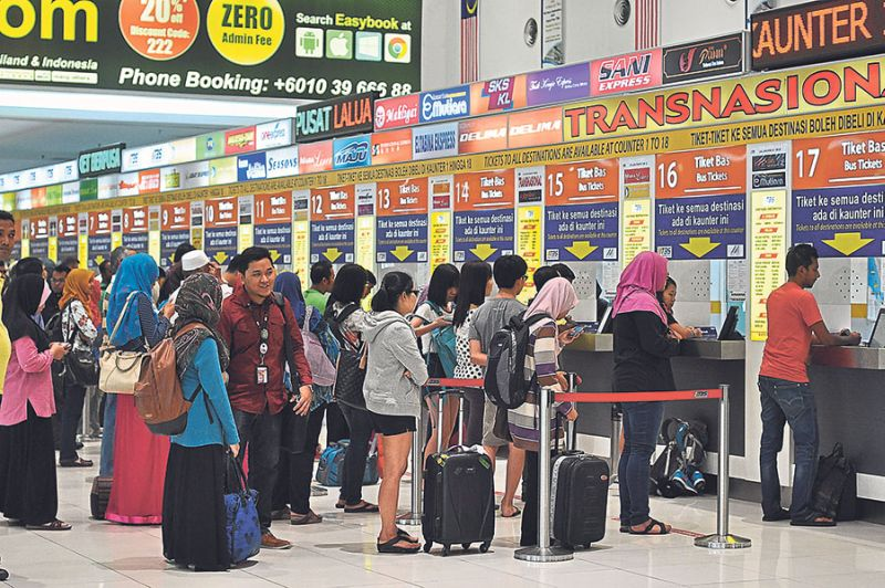 Malaysians are expected to snap up bus tickets, flight tickets and even carpool to return home to vote; while the ETS train tickets are already sold out. — Malay Mail pic