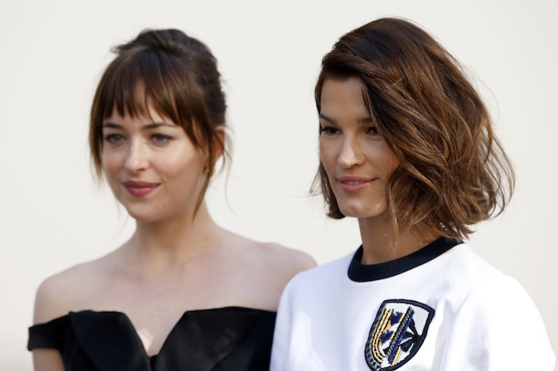 Actress Dakota Johnson (left) and Norway's blogger Hanneli Mustaparta pose before French fashion house Christian Dior Autumn/Winter 2015/2016 women's ready-to-wear collection show during Paris Fashion Week March 6, 2015. — Reuters pic