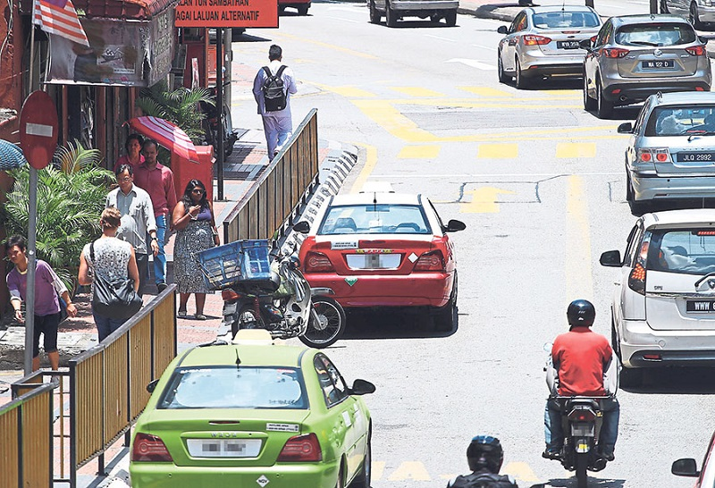 File picture of taxis operating in Kuala Lumpur. Many taxi drivers in four districts in Kelantan have surrendered their permits due to lack of passengers since March last year. — Picture by Azneal Ishak
