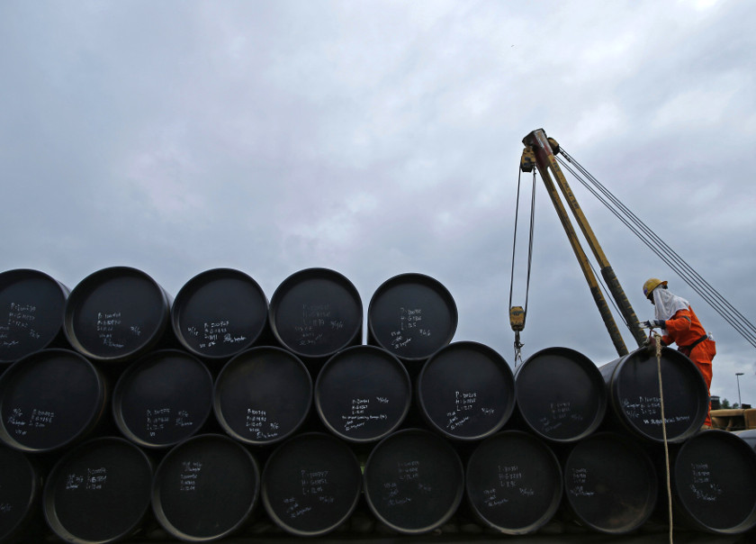 A worker prepares to transport oil pipelines to be laid for the Pengerang Gas Pipeline Project at an area 40km away from the Pengerang Integrated Petroleum Complex in Pengerang, Johor, February 4, 2015. — Reuters pic